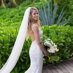 bride poses on her session at rosewood mayakoba