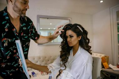 hairstylist does final touches at brides hair