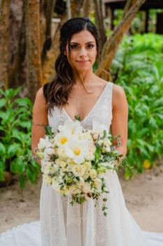 bride poses with her bouquet at delek tulum