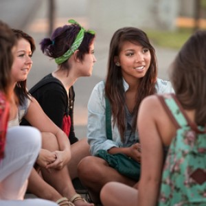 Female Latino Students Talking Outdoors