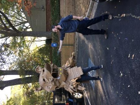Kurt pointing a gun at Alex Feliciano in Cardboard bear costume