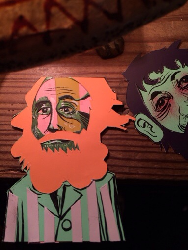 paper cut bearded heads and suits