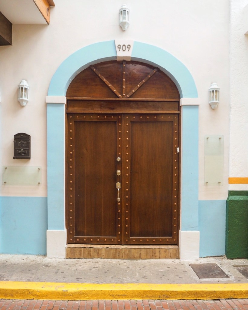a brightly coloured door in Panama