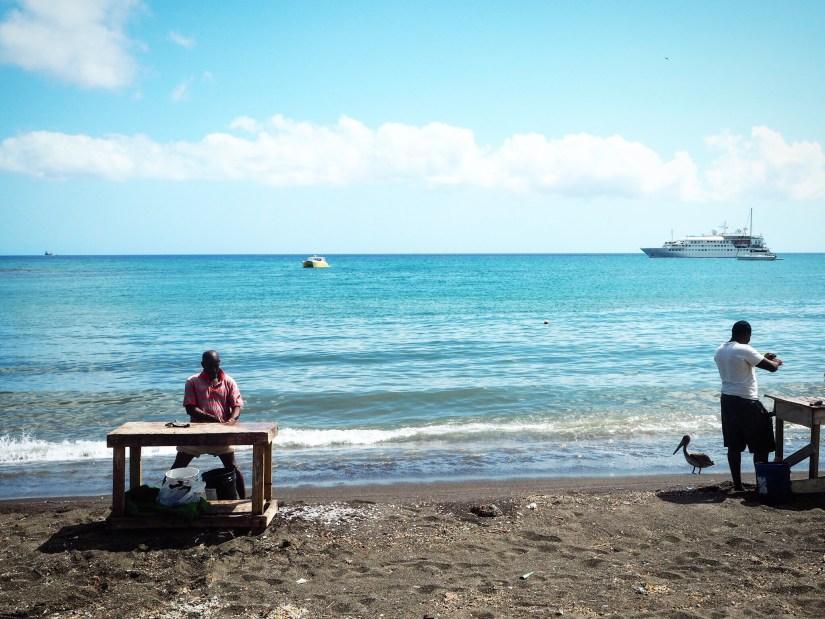Men preparing fish on the beaches in St Kitts