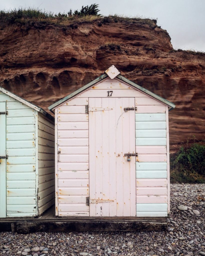 pastel coloured beach huts in south east Devon