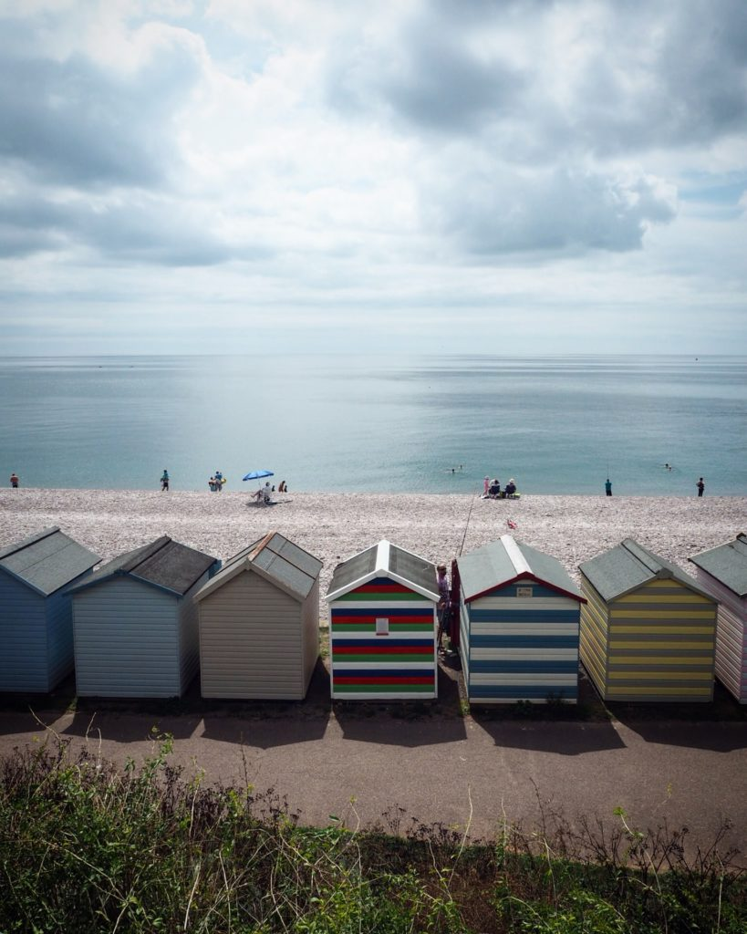 a row of beach huts in Budleigh Salterton, South Devon things to do