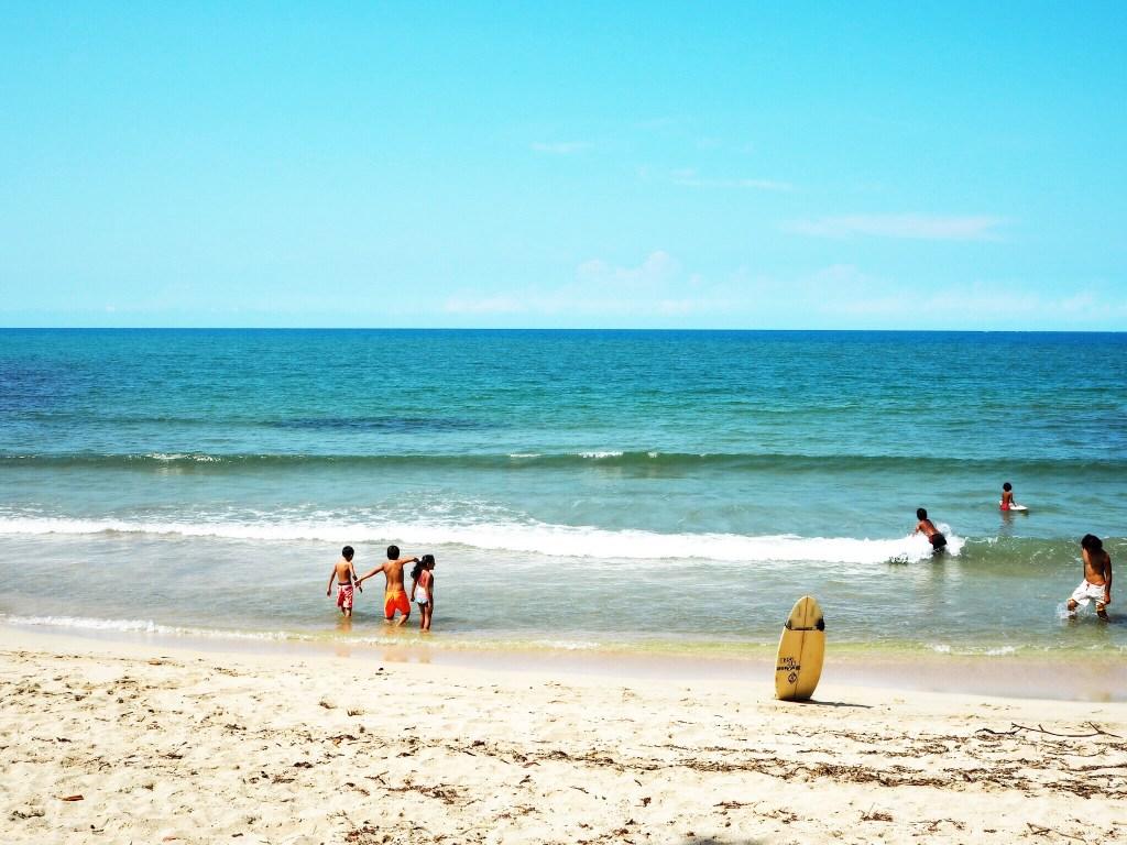 children on the beach in costa rica