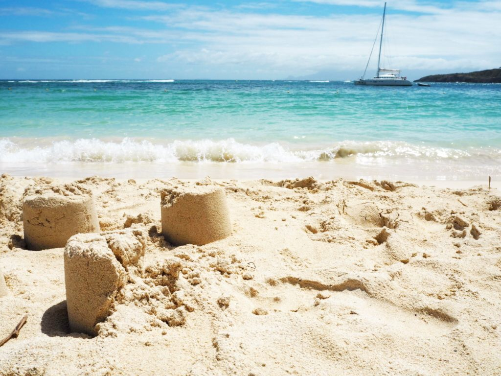 sandcastle on tropical beach place caravelle st Anne guadeloupe