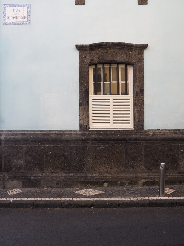 window in a blue wall portugal