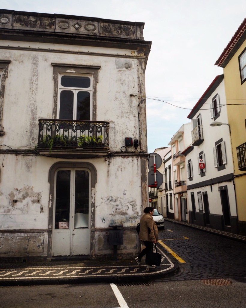 woman walking on a street in the azores