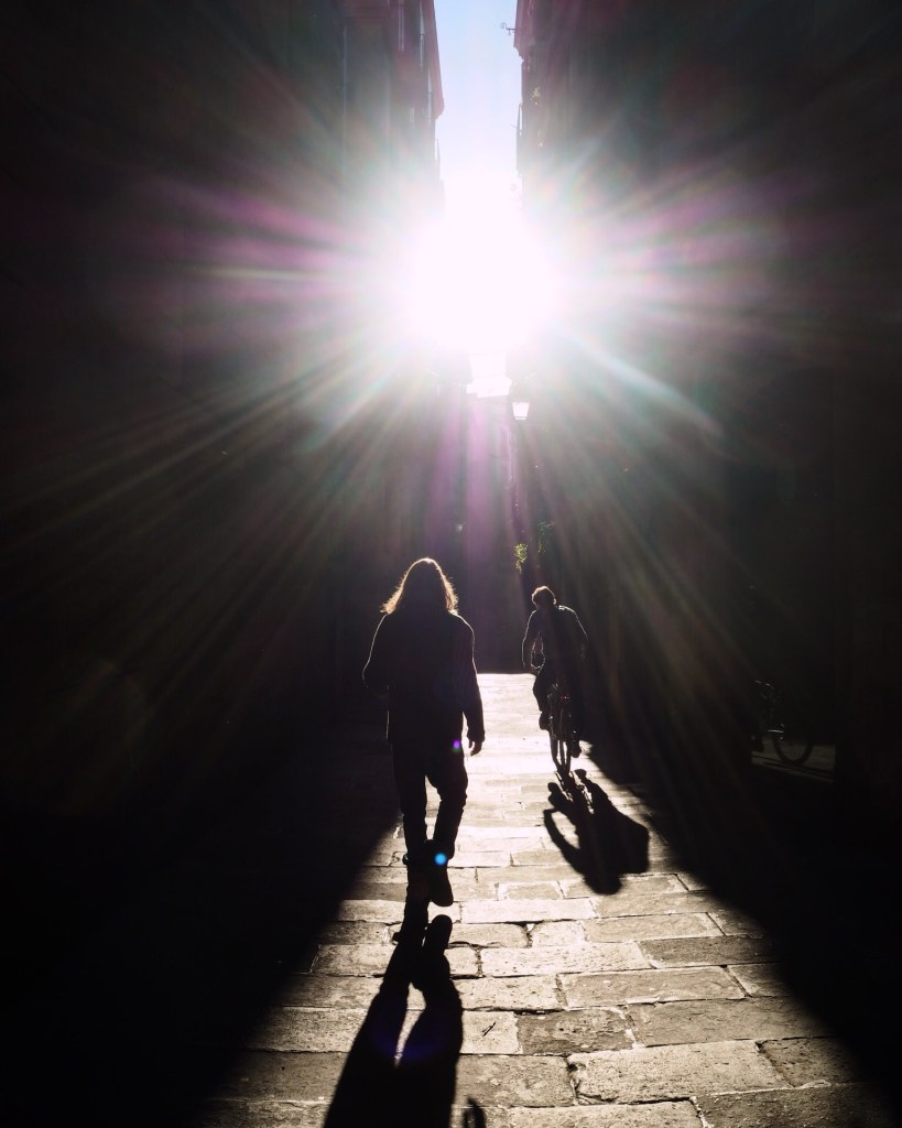 silhouettes in an alleyway in Barcelona