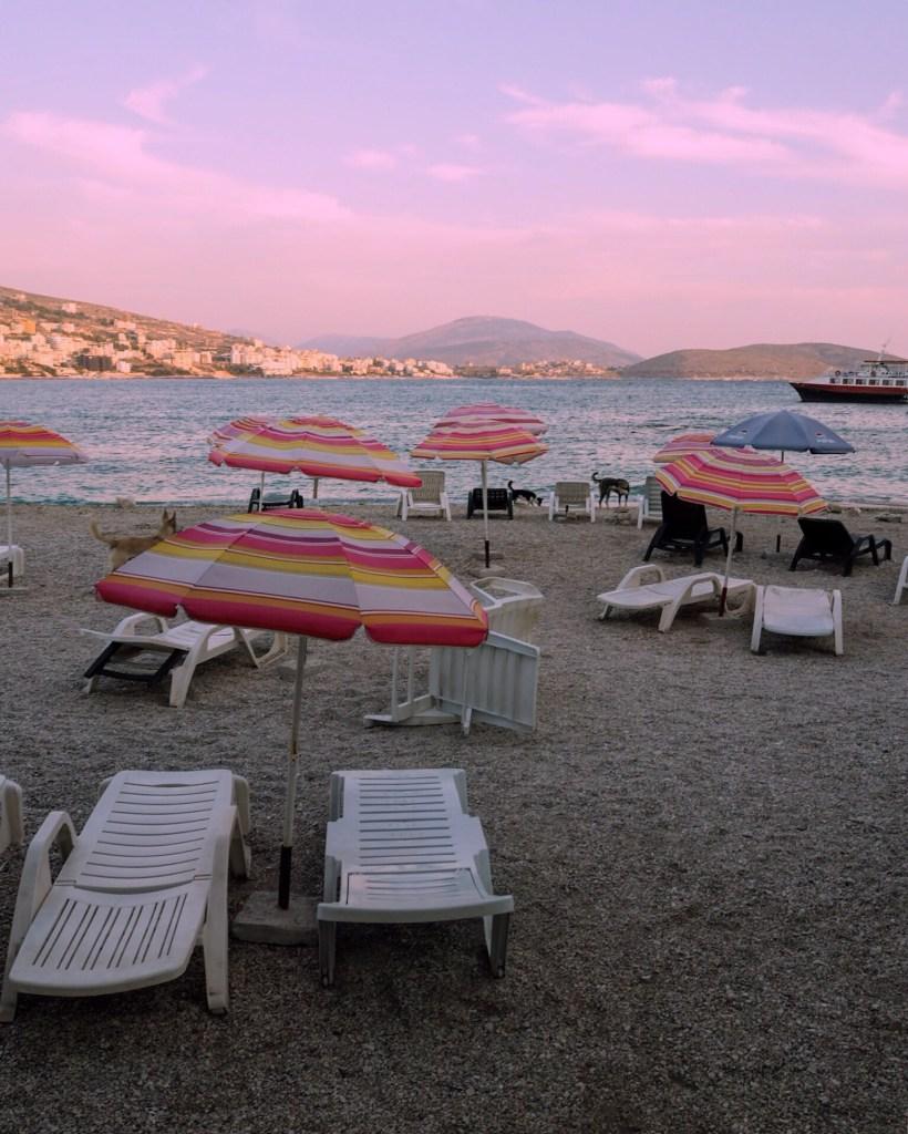 pink parasols at the beach