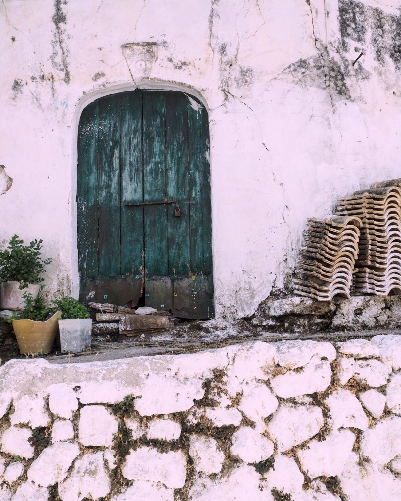 a green doorway on Corfu island greece