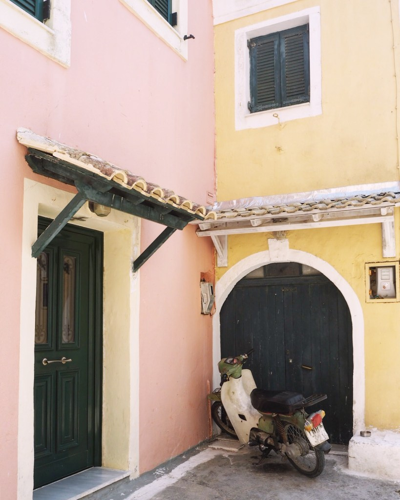 yellow and pink corner with moped