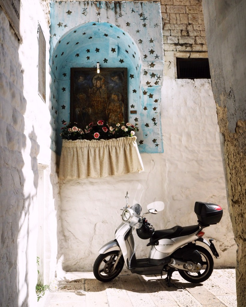 a shrine and a moped in Italy