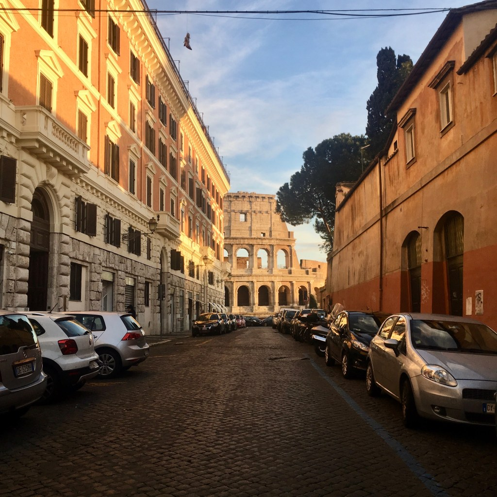 view of the Colosseum at the end of a street