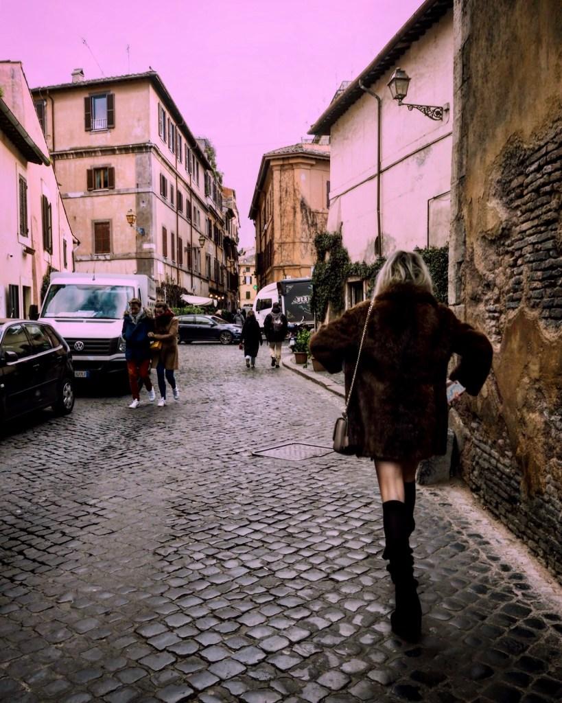 a girl in a fur coat in italy