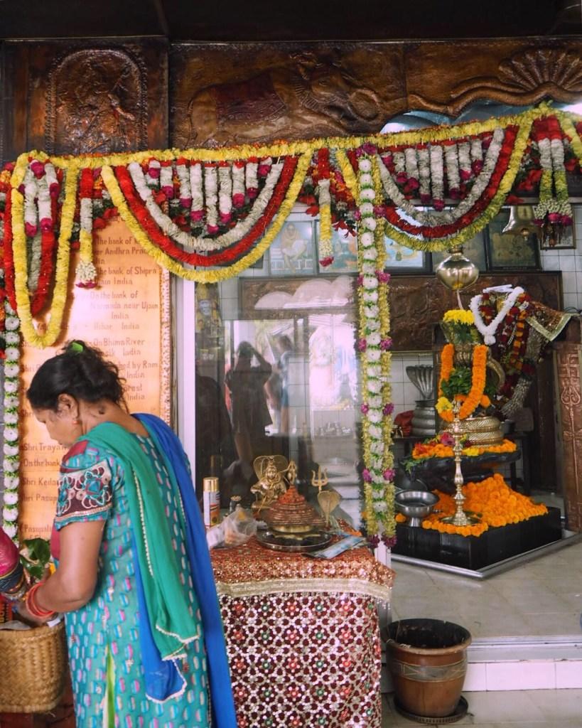 woman praying in Vishnu's temple at Grand Bassin