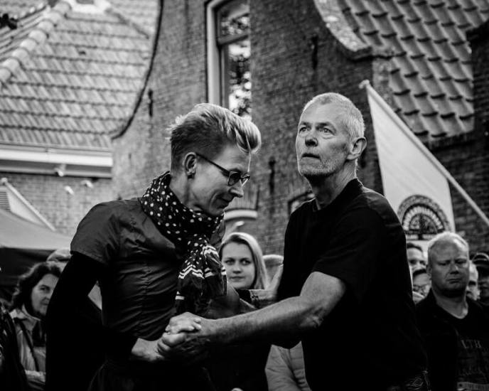 A couple dancing on the street during Rock & Roll Street Terschelling festival 2017.