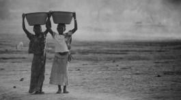 Girls fetching water.