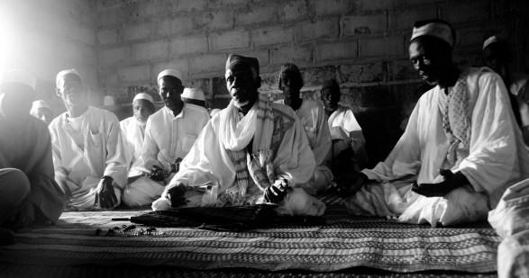 The alkalo (leader) of the village in prayer.