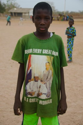 The President of Gambia gives out lots of t-shirts.