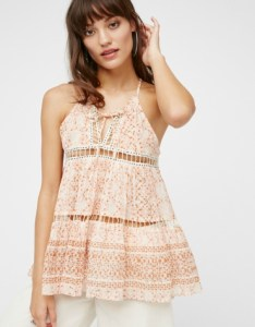 Sheer printed tank featuring cute crochet cutouts and a tie detail at the soft V-neckline