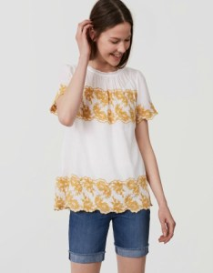 Gilded floral embroidered top in cotton with short sleeves and back button keyhole