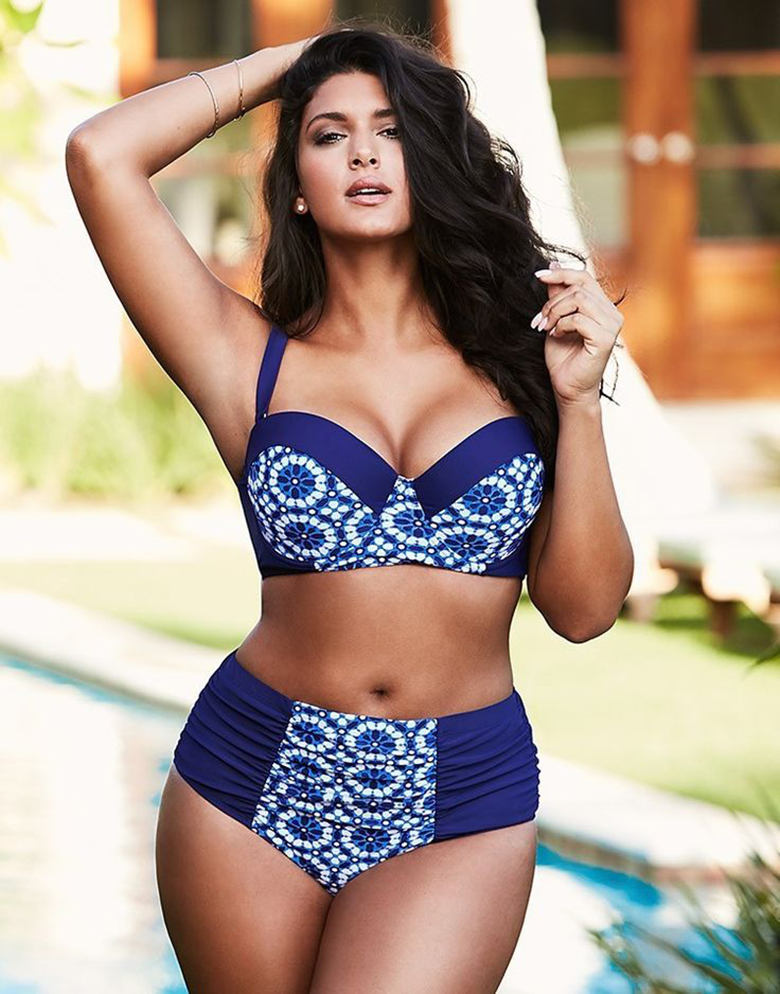 Brunette woman wears a halterneck two-piece swimsuit for big bust