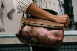 Woman carrying leather Burberry handbag