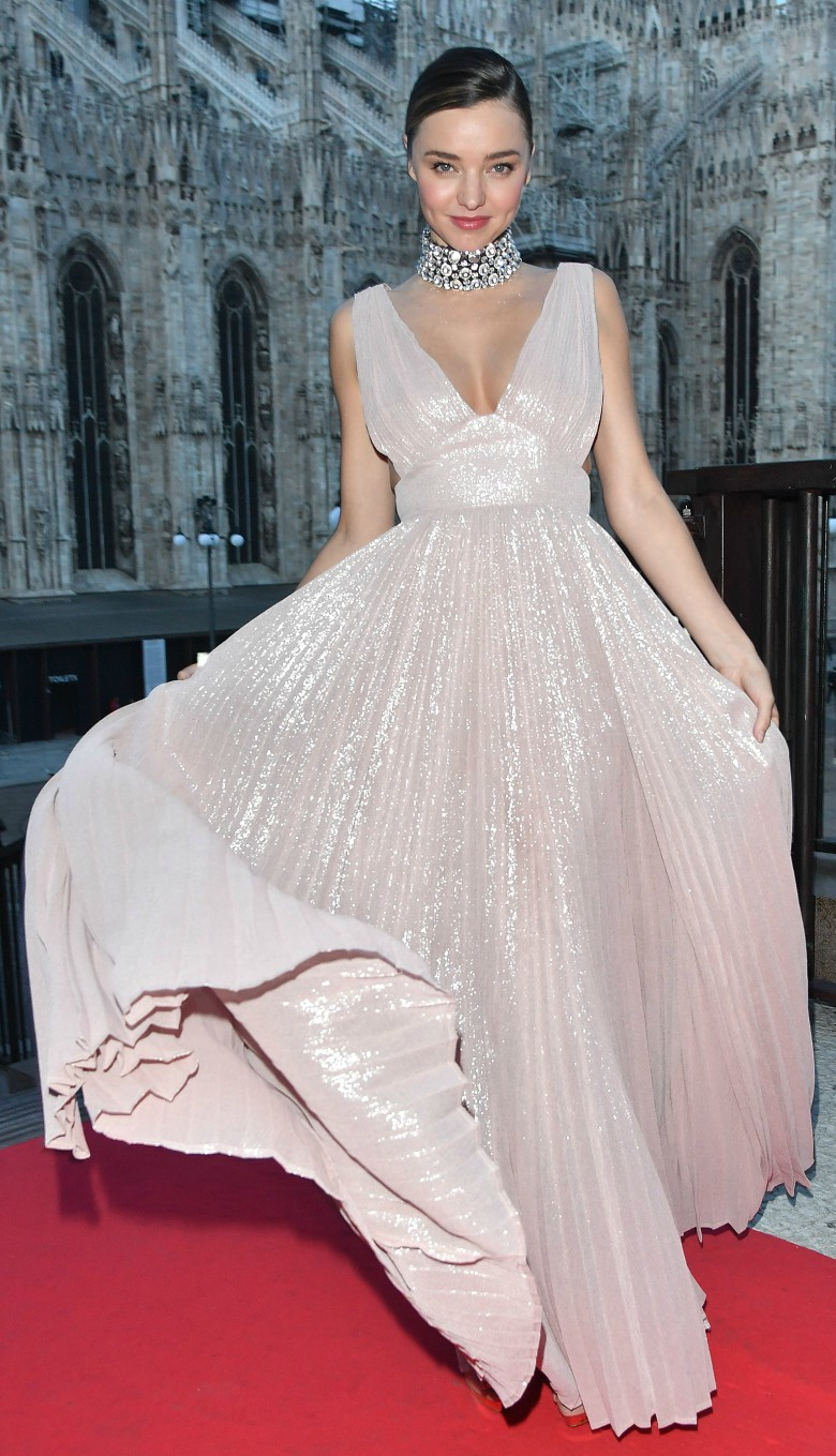 Miranda Kerr at fashion week event wearing full length v-neck gown in light pink and a choker