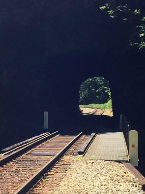 Train tracks through a tunnel