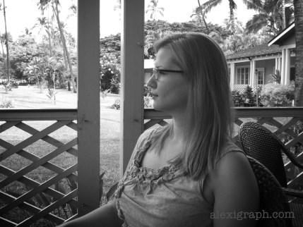 Black and white profile photo of the author sitting on a porch in Kauai