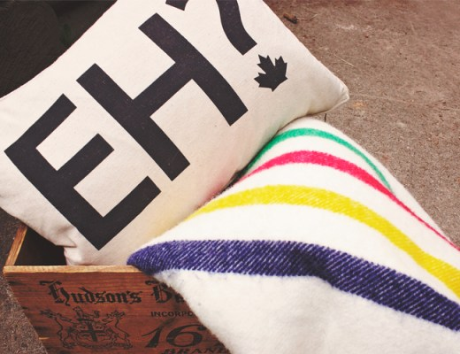 """Canada Day Essentials. """"Eh"""" pillow, Hudson's Bay pointe blanket, Hudson's Bay vintage crate 