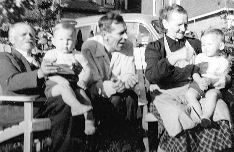 Antoni Frankow with his twin grandsons, Peter and Paul, along with his son and wife, outside on court street