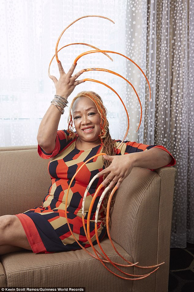 59b15baabbe6d Photos: Woman spends at least 23 years growing the world's longest fingernails, now officially part of the Guinness World Records 2018 edition.