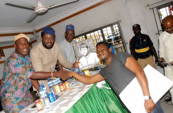 Desmond Elliot donates tricycle to members of Surulere constituency