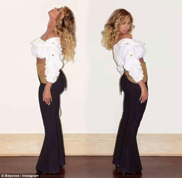 Beyonce flashes her taut stomach in corset detailed trousers and cropped top