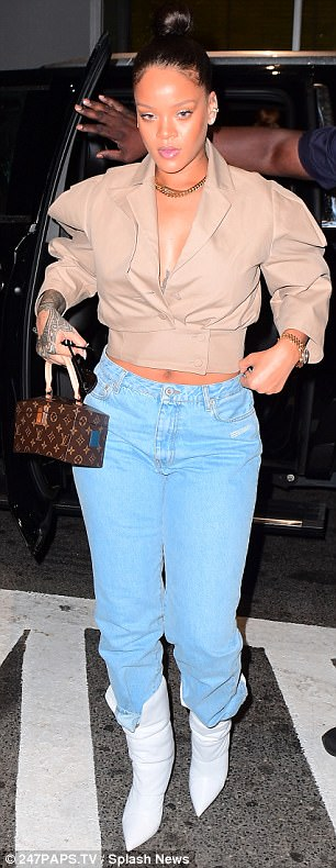 Rihanna flaunts a hint of cleavage and abs in plunging khaki blouse