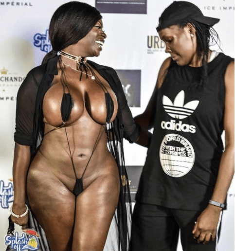 Photo: Between a half-naked lady and a female admirer on the red carpet