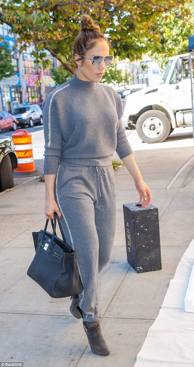 Photos: Jennifer Lopez shows off her famous curves in gray sweatpants as she heads to the studio in NYC