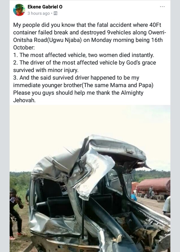 Photo: Driver survives with minor injury after 40ft container falls on his vehicle, crumpling it along Owerri-Onitsha road