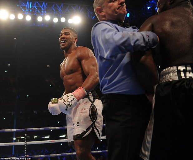 Anthony Joshua beats Carlos Takam in 10th round to retain world heavyweight titles (Photos)