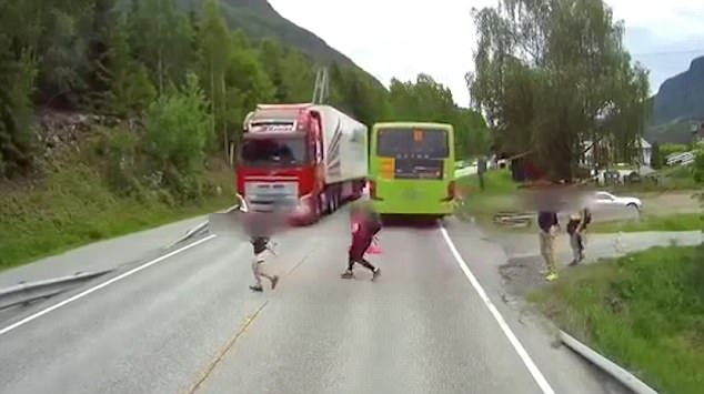 This driver deserves an award! Watch the heart-stopping moment a boy nearly got crushed by a huge lorry (Video)