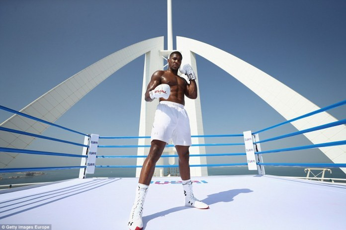 Anthony Joshua shows off his stunning physique during boxing session on top of the Burj Al Arab in Dubai (Photos)