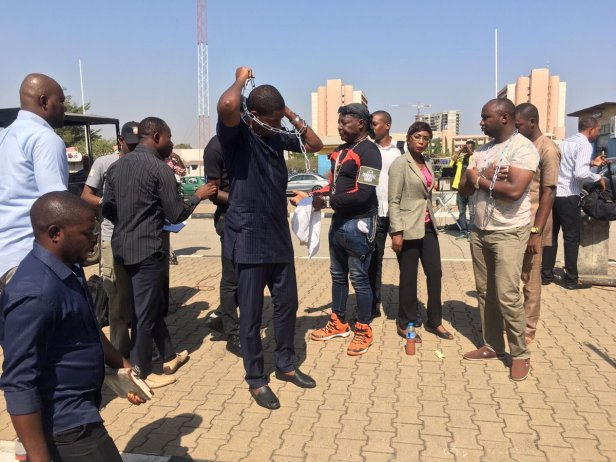 Photos: Charly Boy, Deji Adeyanju, others in handcuff as they stage protest against Libya