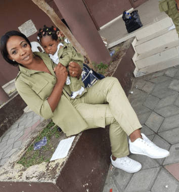 Female Youth corper & her little daughter pose in matching NYSC uniforms (photos)