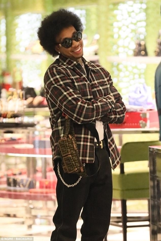Rapper Tyga unveils his new afro look in Beverly Hills (Photos)