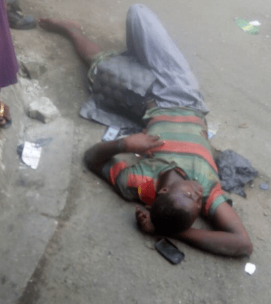 5a5ac9d6d6610 - Hawker falls off the bridge after he is hit by a commercial bus in Lagos (photos)