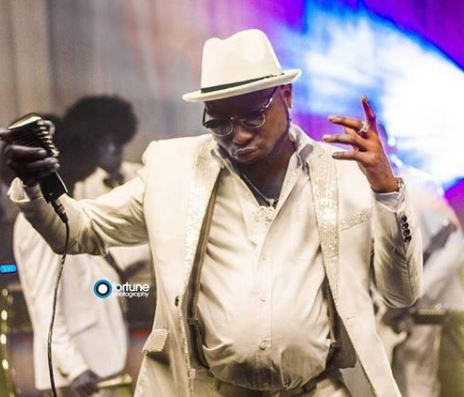 Photos: Davido dress up as an old man with pot belly for new music video